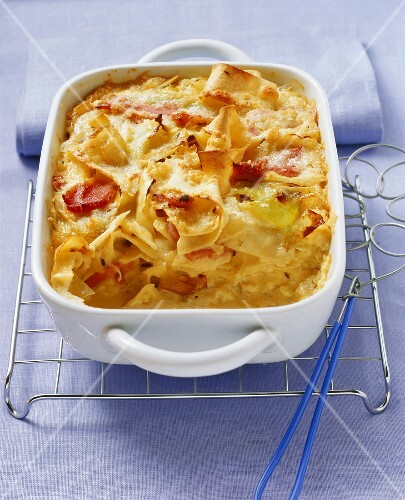 Pasta bake with white cabbage and ham in baking dish