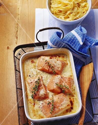 Salmon fillets au gratin and a bowl of ribbon pasta