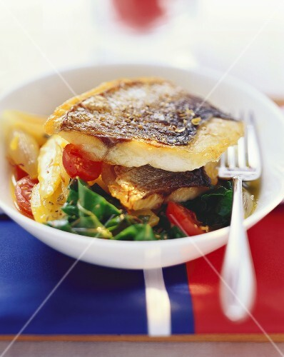 Sea bass on fennel and mixed vegetables with saffron