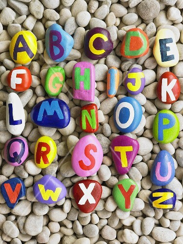 Alphabet painted on pebbles