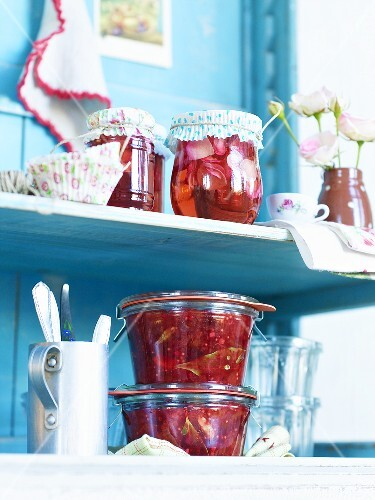 Rose jelly and plum chutney in preserving glasses