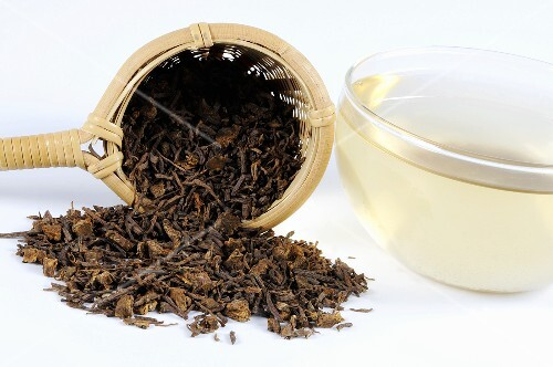 Tea with dried aster root and a tea strainer