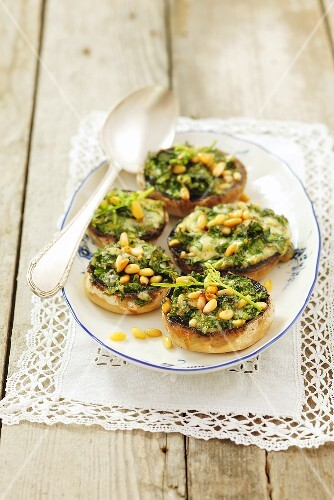 Stuffed mushrooms with rocket, blue cheese and pine nuts