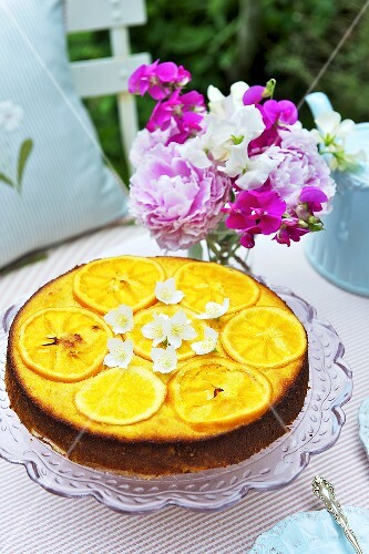 Orange and almond cake on a garden table