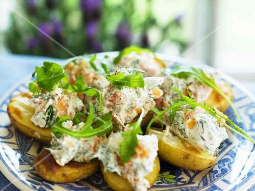 Roast potatoes with a salmon and dill cream and rocket