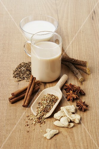 A cup of Yogi tea with spices and a small bowl of milk