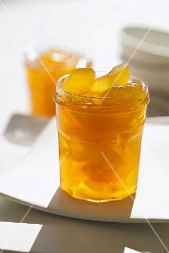 Apple slices preserved in brandy in a jar