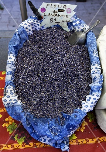 Lavender flowers in a basket at the market in Vaison-La-Romaine, Provence
