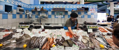 A trader at a fish market in Saint-Jean-de-Luz, South of France