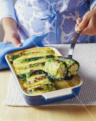 Baked stuffed savoy cabbage leaves with fish & potato stuffing
