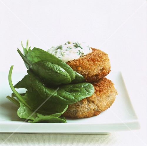 Fish cakes with sauce tartare and baby spinach