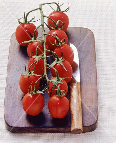 Vine tomatoes on chopping board