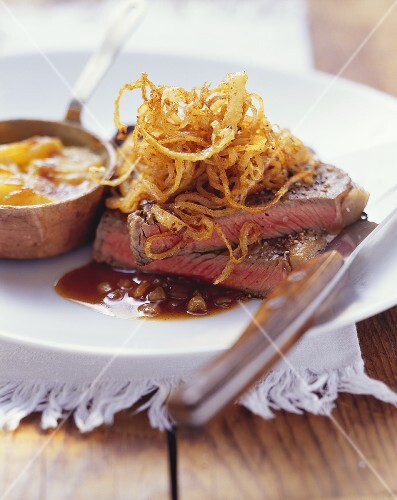 Steak and onions with potato gratin