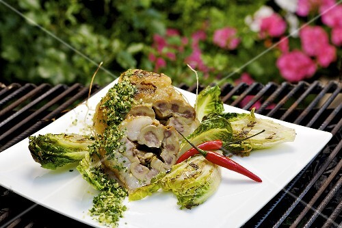 Veal kidney in fat with romaine lettuce & gremolata