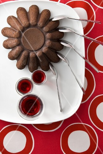Chocolate cake, spoons, glasses of red wine (from above)