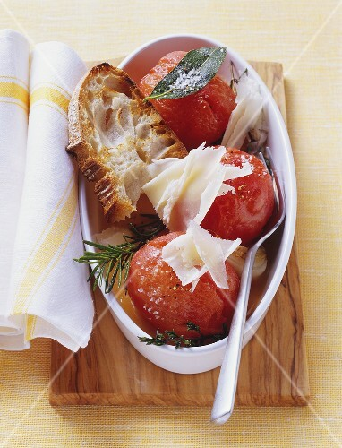 Baked tomatoes with toasted white bread and cheese