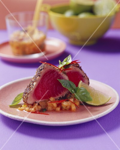 Fried tuna in pepper crust on melon salsa