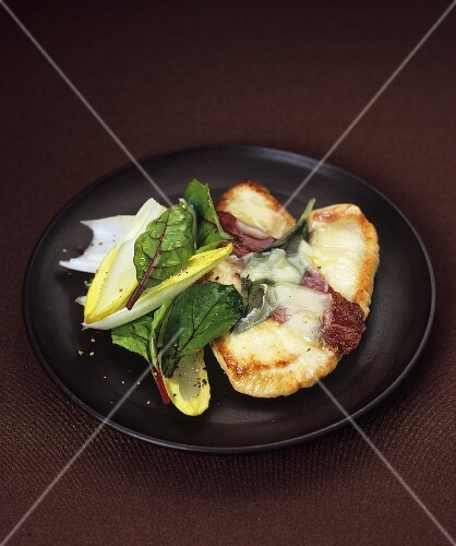 Turkey escalope with bacon, melted cheese and sage
