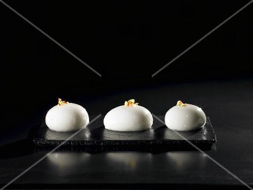 Corn-fed chicken and coconut milk, inverted, oriental (molecular gastronomy)