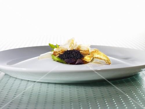 Smoked gelatine, caviar, potato chips, grated sturgeon (molecular gastronomy)