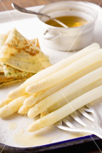 White asparagus with herb pancakes