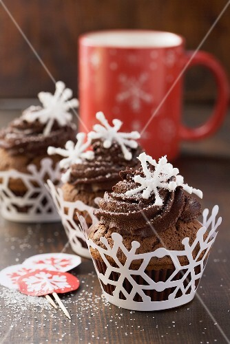 Chocolate cupcakes with coffee cream and sugar decorations