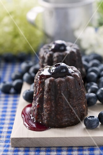 Cannelès with blueberry sauce