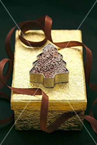 A chocolate Christmas tree on a golden gift box