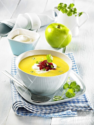 Curry soup with sour cream, apple, fresh coriander