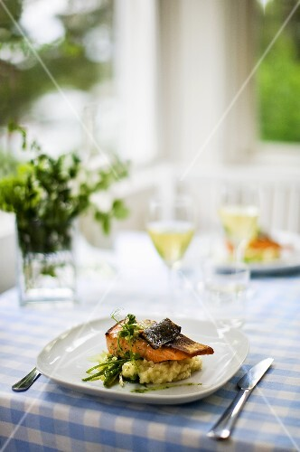 Oven-roasted salmon with lemon butter on risotto