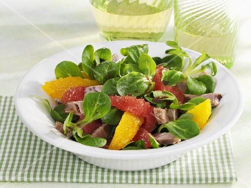 Corn salad with pork and citrus fruit