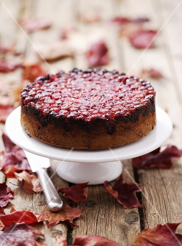 Cranberry upside-down cake on cake stand