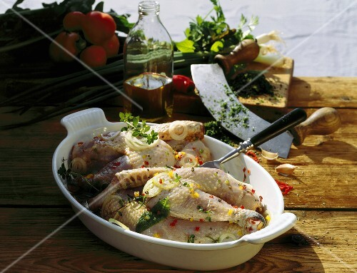 Chicken in herb and oil marinade