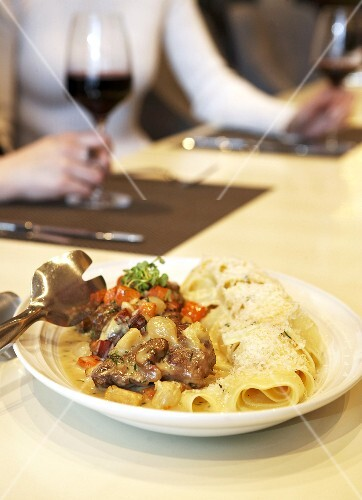 Veal cheeks with mushroom sauce and pappardelle