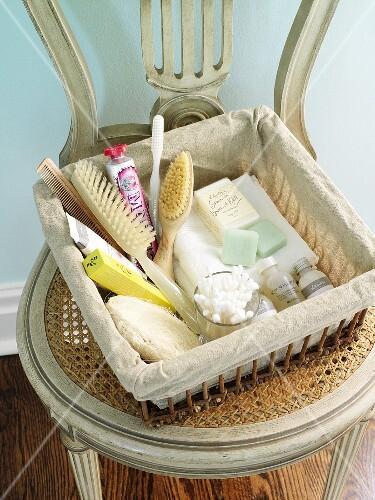 Basket of bathing accessories (hairbrush, toothbrush, soap etc.)