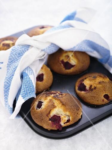 Raspberry muffins in a muffin tin