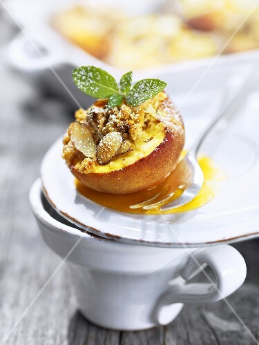 Baked peach with almond crumble topping
