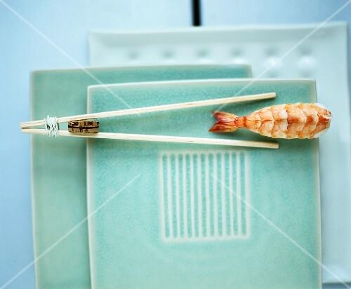 Chopsticks with nigiri sushi