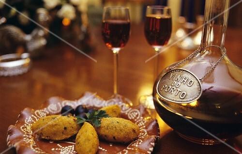 Bolinhos de bacalhau (potato and stockfish balls from Portugal) and port