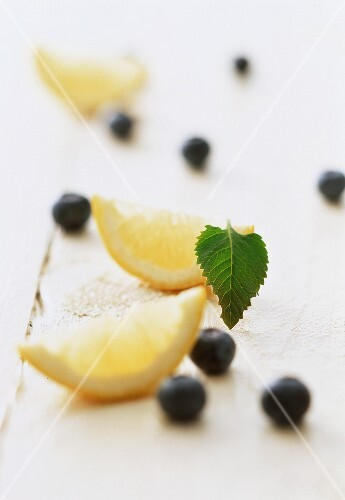 A display of lemon slices and fresh blueberries