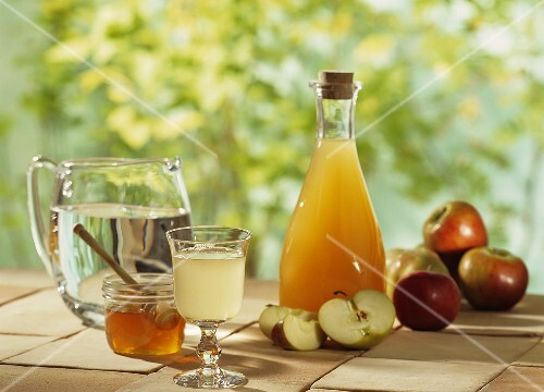 A display of apple vinegar and apples