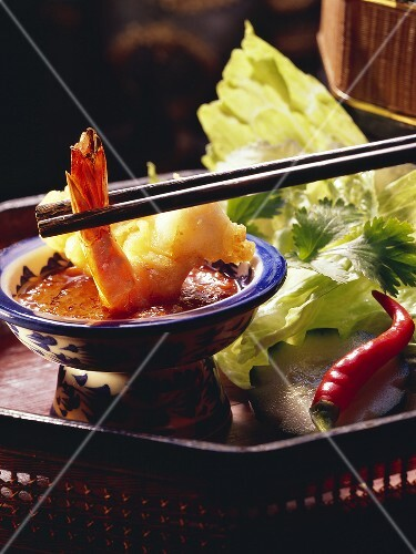 Baked scampi and a chilli dip in a bowl with chopsticks