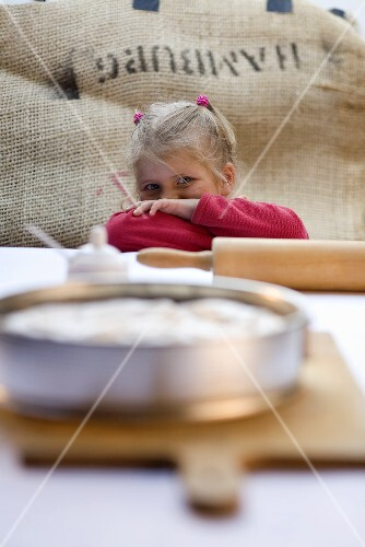 A little girl with a rhubarb meringue pie