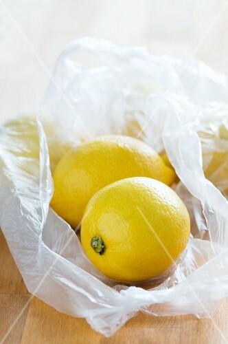 Lemons in plastic bags