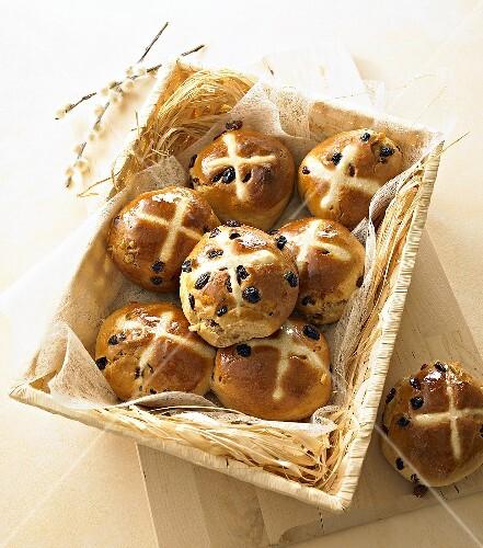Hot cross buns in a bread basket