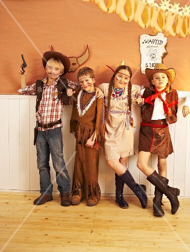 Four children dressed as cowboys and Indians