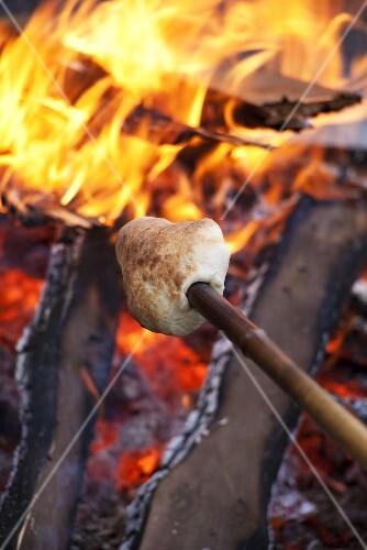 Stick bread over a campfire