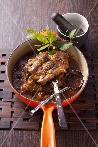 Braised collar steaks with a spicy bread sauce