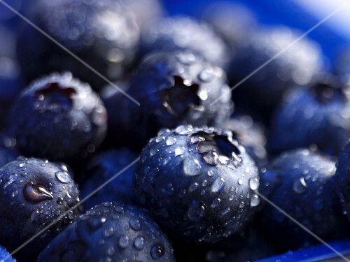 Blueberries with drops of water (close-up)