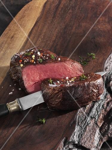 Roast fillet of beef on a wooden board